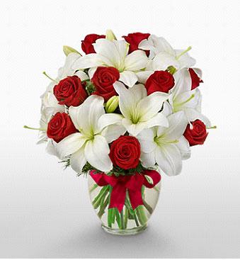 Hatay hediye sevgilime hediye çiçek  1 dal kazablanka 11 adet kırmızı gül vazosu